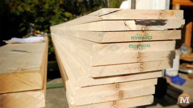 MAN about TOOLS - firewood cutting jig - side boards stacked up
