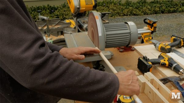 Reduce end of dowel to fit into pipe - man about tools cast form mold concrete garden boxes