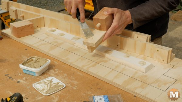 Fill screw head holes with wood filler - man about tools cast form mold concrete garden boxes