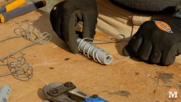Wrap wire around pipe to reinforce concrete - cast garden boxes