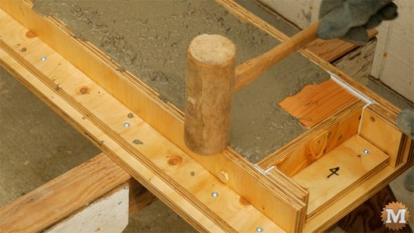 Tap with hammer to settle concrete and remove bubbles