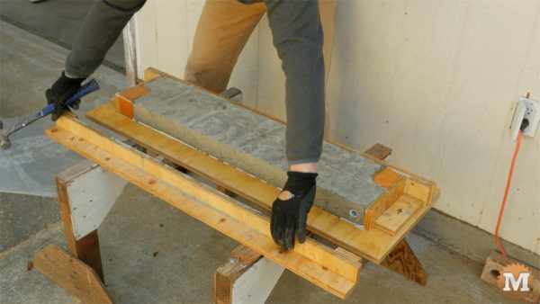 Remove screws and gently remove sides and ends - cast form mold concrete garden boxes
