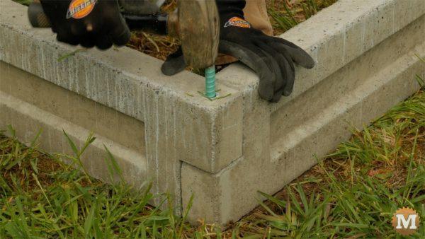 "Secure corners with 12\"" epoxy coated rebar"
