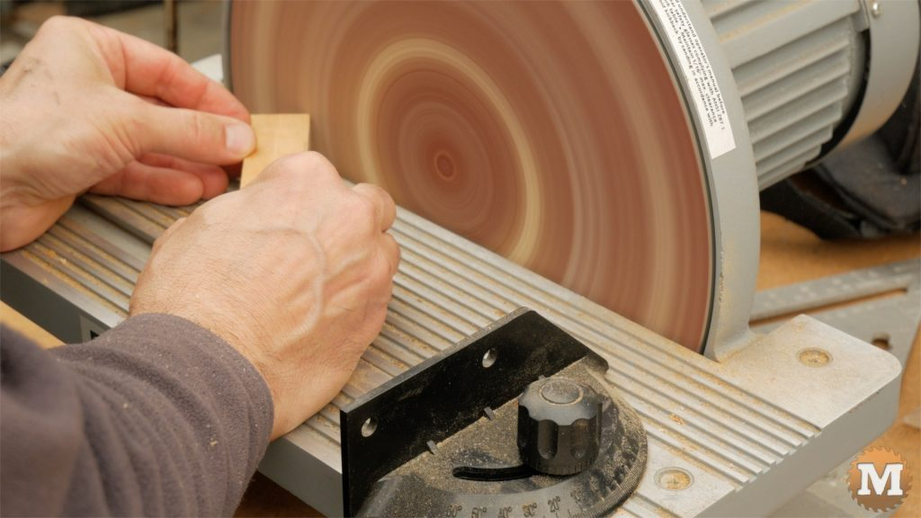 DIY One Handed Cutting Board - chamfer edges and corners on disc sander