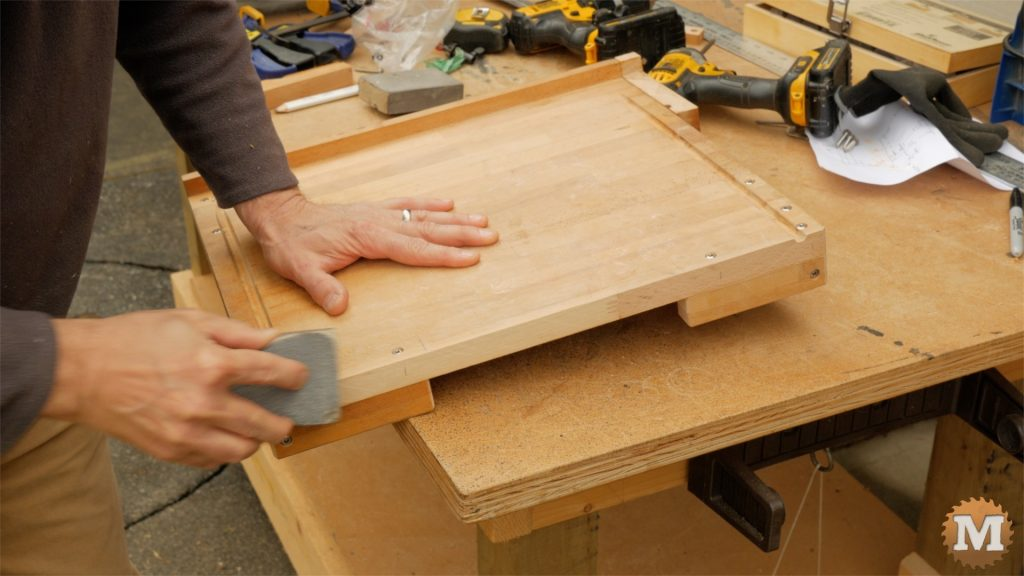 DIY One Handed Cutting Board - finish up with sanding block