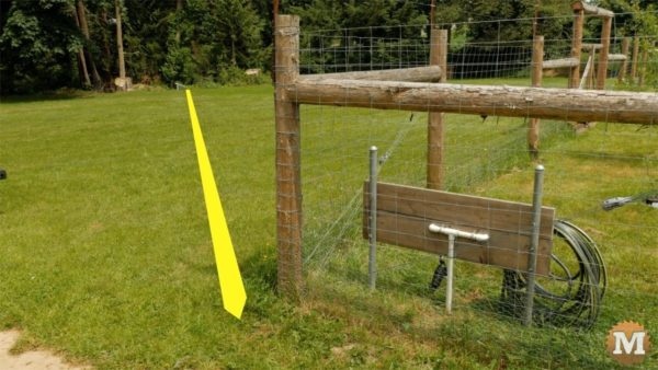 """1"""" black poly water line runs under field to house"""