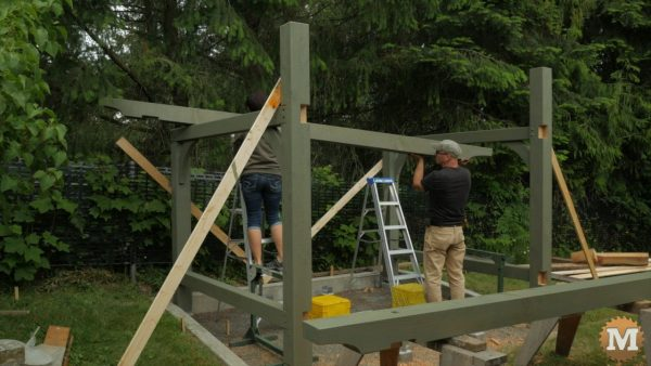 Timber Frame Shed - Setting back beam in place with help from my wife, Marilyn