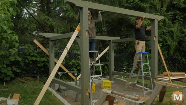 102 Timber Frame Woodshed Firewood Shed - Setting the front beam in place