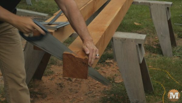 Cut the long beams and four sides with circular saw, then finish the cut with a hand saw - Firewood Shed