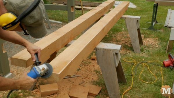 Timber Frame Firewood Shed - Chamfer the beams with a power hand plane, then finish with angle grinder