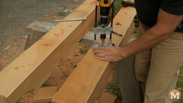 Drill beams for long lag bolts - Timber Frame Firewood Storage Shed