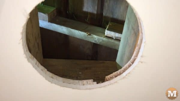 Hole in ceiling cut out, blocking between rafters added. The rafter section that was removed can be seen better in this picture