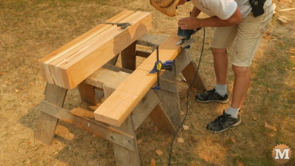 Rafters cut on sawhorses with jigsaw