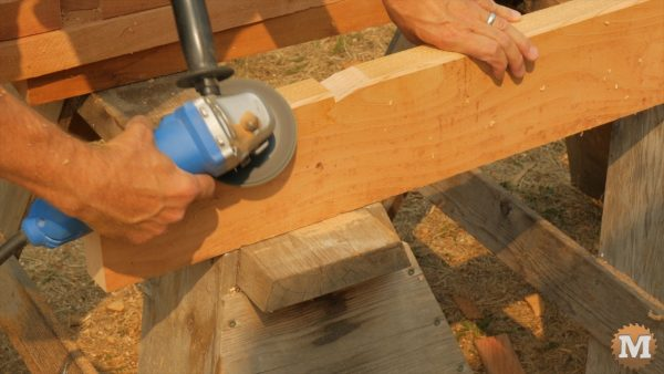 Rafters dressed and chamfered with sanding disc on angle grinder