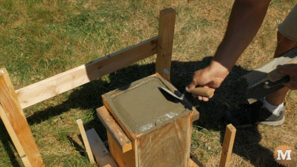A chamfer on the top edge is formed by hand with small trowel - Finishing Concrete