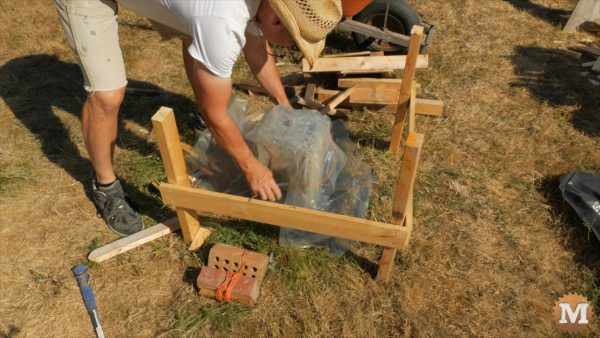 Exposed piers are kept covered with plastic to properly cure - Timber Frame Pavilion