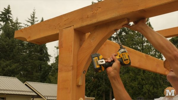 Lag bolt is driven in with impact driver - Dewalt Cordless