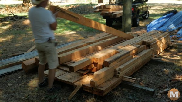 Selecting beams and posts from a drying pile