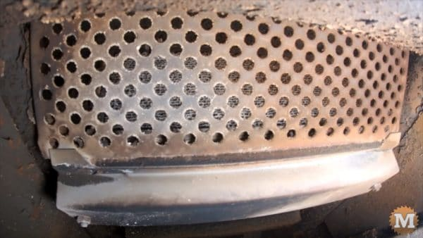 Catalytic converter sits behind this protective metal screen