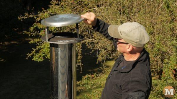 Remove rain cap from chimney