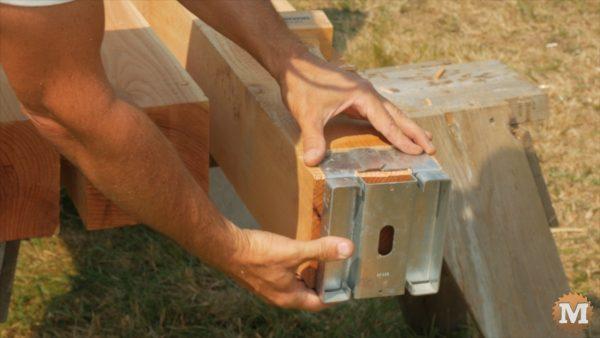 Post ends trimmed to fit galvanized metal saddle - Timber Frame Pavilion