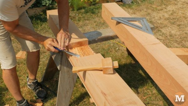 Front posts have a deep slot cut on the outside face to receive the side girt - Timber Frame Pavilion