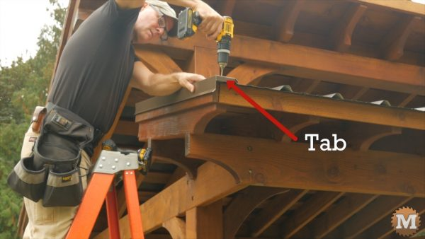 Adding metal rake trim to gable ends of shed roof sections