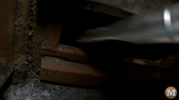 Crevice tool fits past the bypass door to pick up some creosote flakes