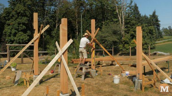 Final pavilion post being erected