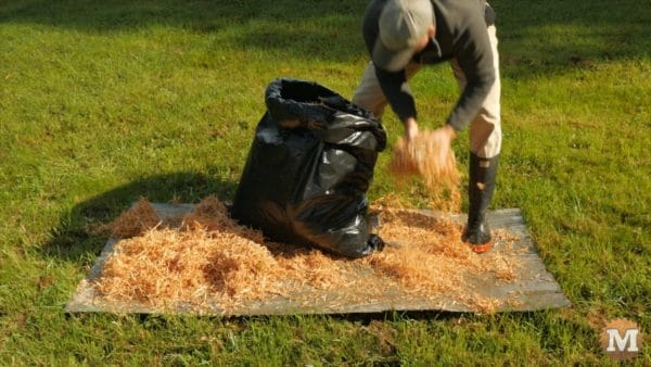 Drying cedar shavings in the sun on some scrap metal