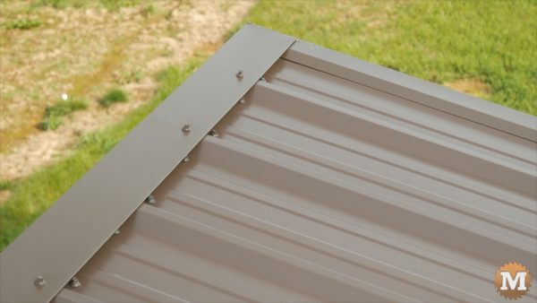 High eve trim sits flat across leading edge of roof panels