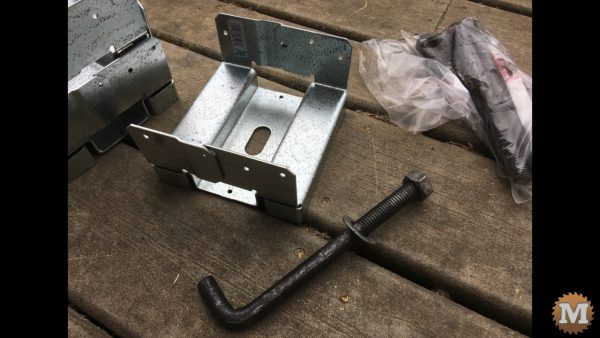 Adjustable galvanized post saddles and anchor bolt