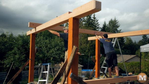 Sliding the third beam into place - gazebo building