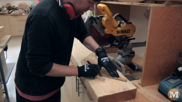 marking braces for the Three Gable Timber Frame style Pavilion to be cut on a miter saw