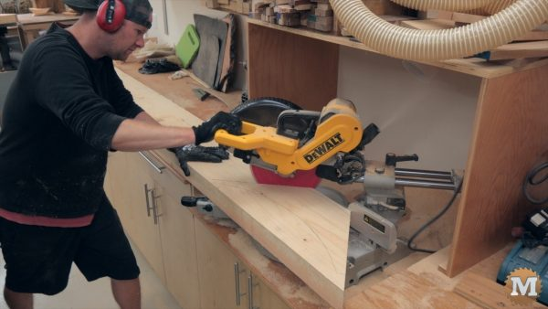 miter saw cutting the corner braces for the Timber Frame style Pavilion from fir