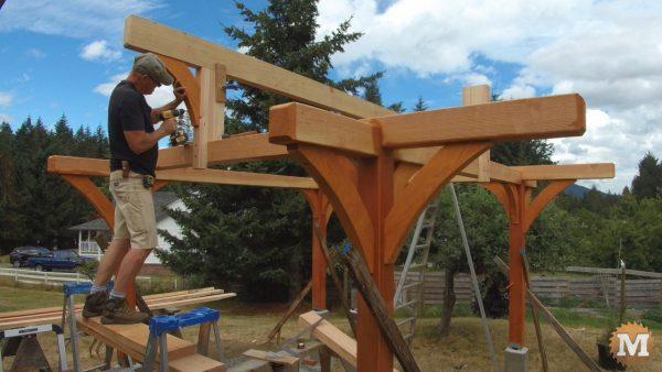 installing a brace on the Three Gable Timber Frame style Pavilion ridge beam