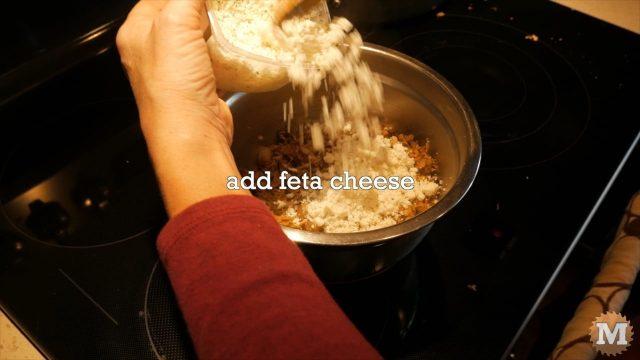 Adding feta cheese to the Winter Chanterelle Mushroom tart filling