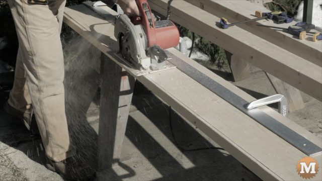 ripping lumber with circular saw and guide
