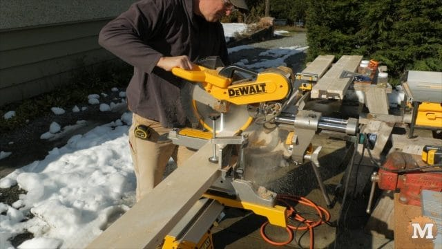 Cutting the side pieces to length on the miter saw