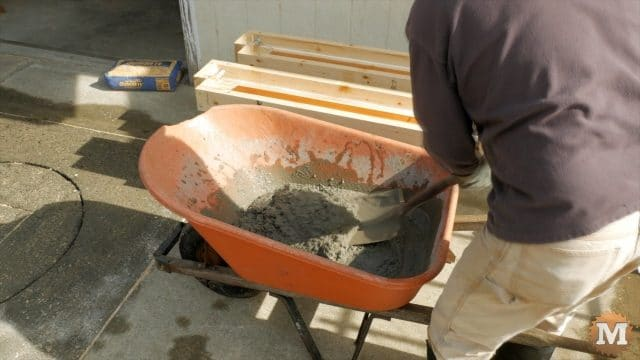 Mix concrete in a wheel barrow