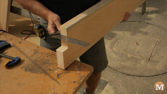 using a square to check the cut on the form base