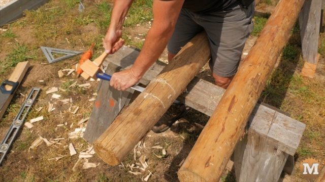 Knocking out wood with mallet and chisel