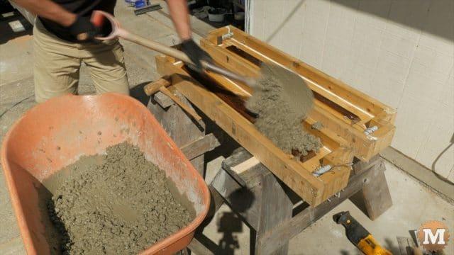 Shovelling Lavarock concrete into a form