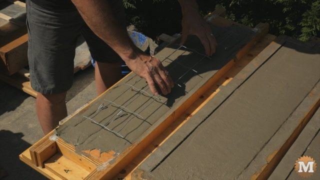 Adding galvanized wire grid after aircrete thickens