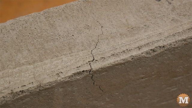 Cracks formed along the upper inside edge of the panels as a result of the bowing