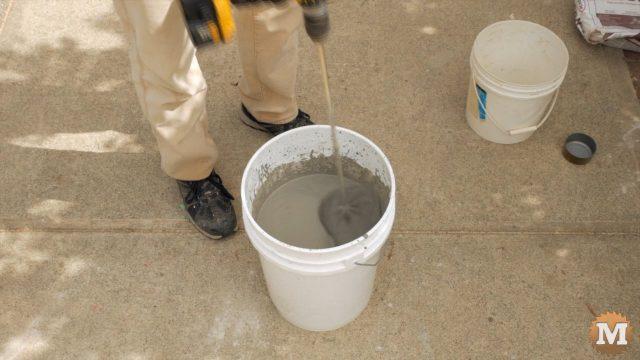 Mixing concrete in a pail
