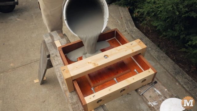 Pouring concrete in form