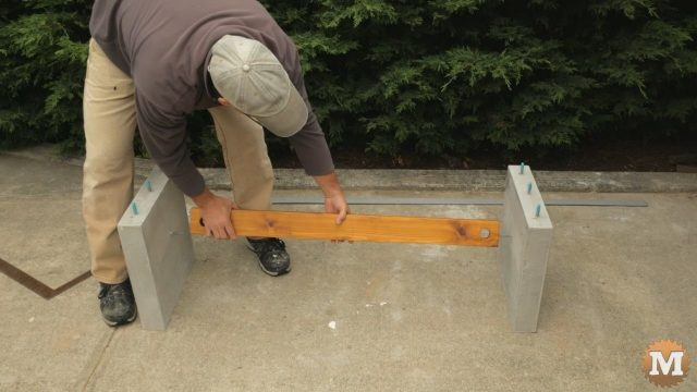 Sliding stretcher onto bolts in legs