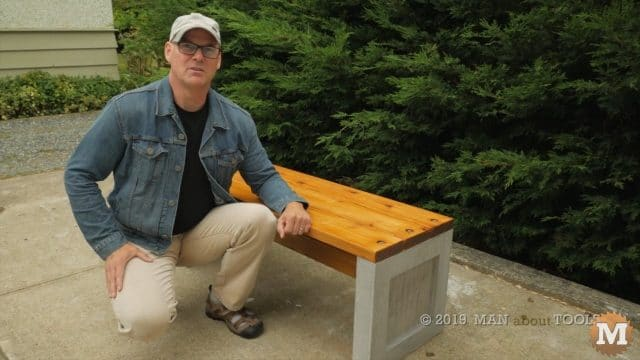 the author and the outdoor concrete garden bench