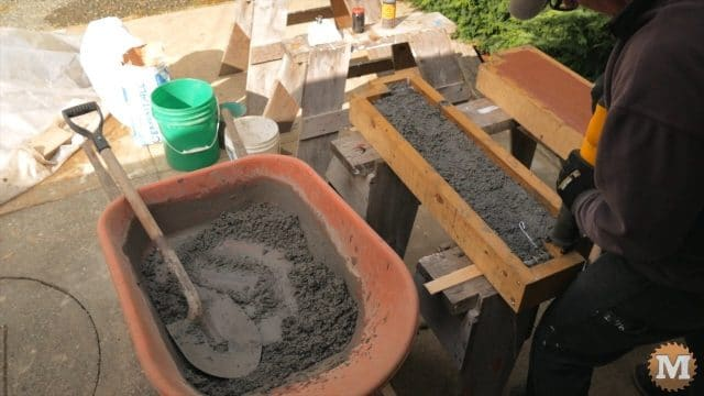 CSA Perlite wet concrete being vibrated to settle in form